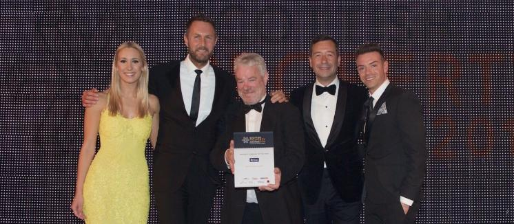Artisan picking up their prize at the Scottish Property Award for Property Company of the Year